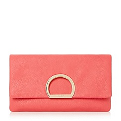 Dune - Bright pink 'Elex' circular detail flap over clutch bag