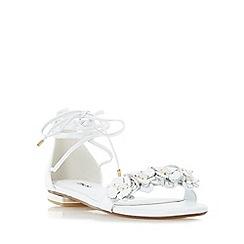 Dune - White 'Nigella' ghillie lace up flower trim flat sandal