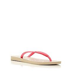 Havaianas - Pink slim strap animal print flip flop