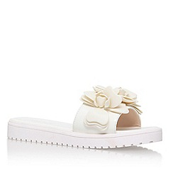 Nine West - White 'Radella3' slip on sandle with flower detail