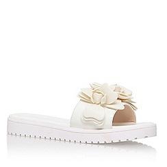 Nine West - White 'Radella3' slip on sandle with flower detail