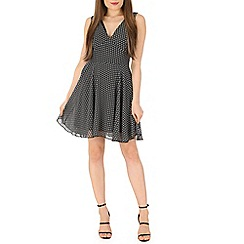 Mela - Black v-neck spot dress