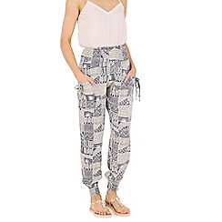Izabel London - Navy  patchwork print trousers