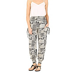 Izabel London - Cream  patchwork print trousers