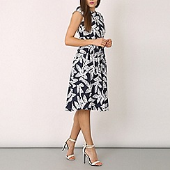 Izabel London - Navy pleated occasion dress with palm midi print