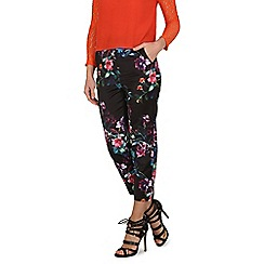 Cutie - Black floral print trousers