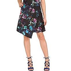 Cutie - Black wrap over floral skirt
