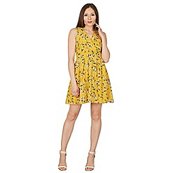 Tenki - Yellow v-neck floral tie back dress