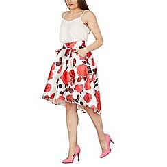 Cutie - Pink floral print highlow skirt