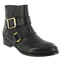 Marta Jonsson - Black ankle boot with a gold buckle