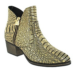 Marta Jonsson - Gold ankle boot with a zip
