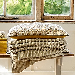 Christy - Ochre 'Clara' cushion