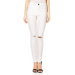Quiz - White knee rip jegging