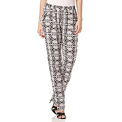 Quiz - Black and Cream Tile Print Zip Trousers