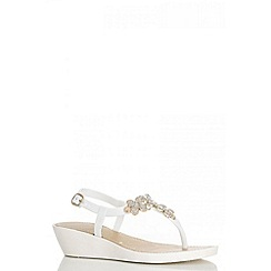 Quiz - White glitter flower wedges