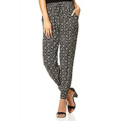 Quiz - Black geometric print harem trousers