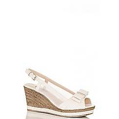 Quiz - White shimmer bow sling back wedges