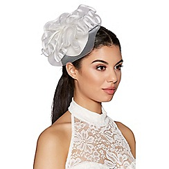 Quiz - White feather edged fascinator