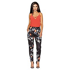 Quiz - Black and orange floral print tapered leg trousers