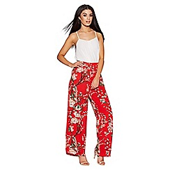 Quiz - Red crepe floral print palazzo trousers
