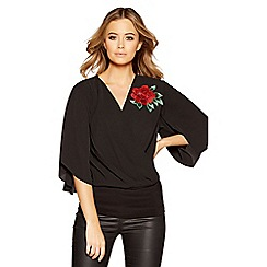 Quiz - Black and red floral cross over top