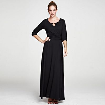 Black maxidress with gold bar in clever fabric