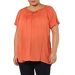 Evans - Orange tassel gypsy top
