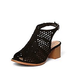 Evans - Black punchout block heels