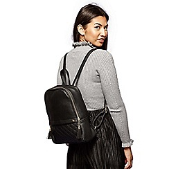 Yumi - Black quilted pocket with rucksack