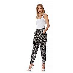 Yumi - Black Floral Print Trousers