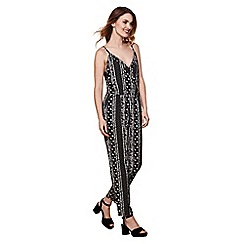 Yumi - Black floral stripe strappy jumpsuit