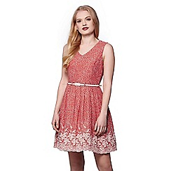 Yumi - Orange embroidered hem skater dress