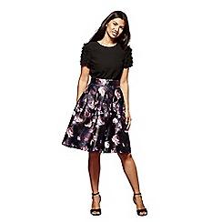 Yumi - Black full bodied rose printed skirt