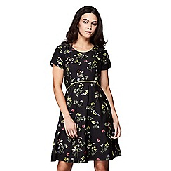 Yumi - Black garden bird printed tea dress
