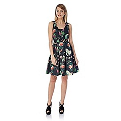 Yumi - Botanical print skater dress.