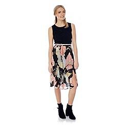 Yumi - Statement black floral midi skirt