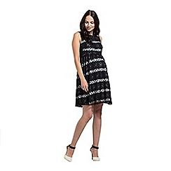 Rock-a-Bye Rosie - Black polka dot babydoll dress