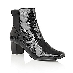 Lotus - Black 'Swallow' animal print ankle boots