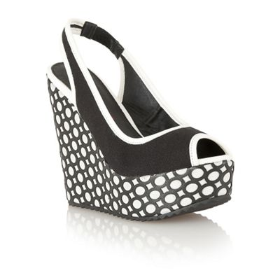 Dolcis Black sling back pattern cut out wedges - . -