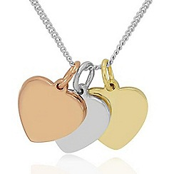 Precious Moments - Trio of polished hearts in silver and 9ct gold plate