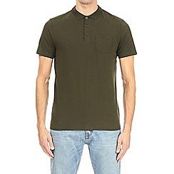Burton - Forest green stretch polo shirt