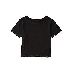 Outfit Kids - Girls' black pom pom t-shirt