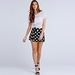Girls On Film - Black and white polka dot skirt