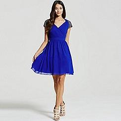 Little Mistress - Blue exposed back embellished prom dress