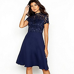 Chi Chi London - Navy broderie chiffon 'Brigitta' high neck short sleeve knee length dress