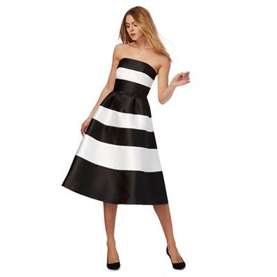 Red herring black and white dress