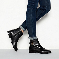 Faith - Black leather buckle detail 'Broganer' flat ankle boots