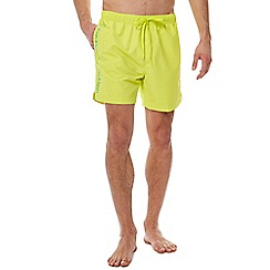 Calvin Klein - Yellow logo tape swim shorts