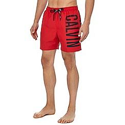 Calvin Klein - Red logo print swim shorts