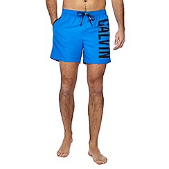 Calvin Klein - Blue logo print swim shorts